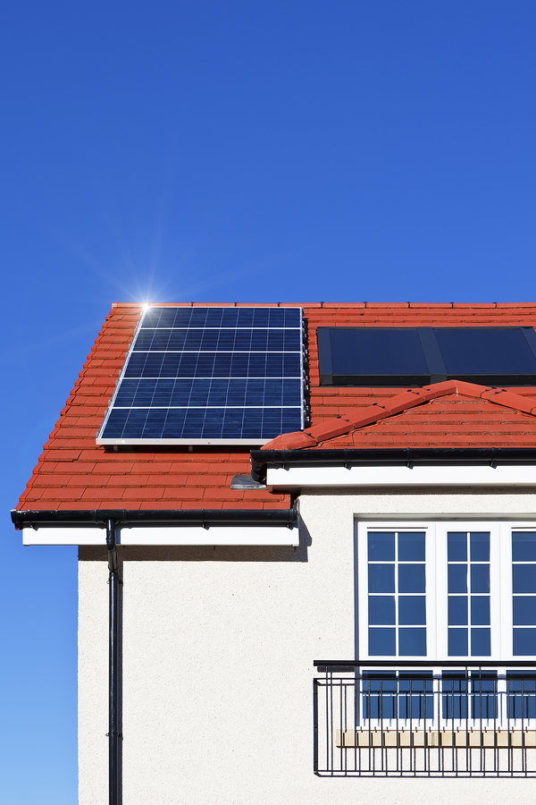 roof of two story house with solar panels