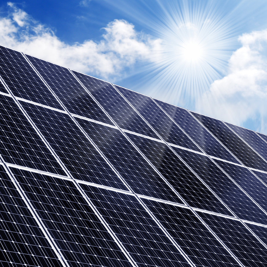 solar panels with sun shining solar energy